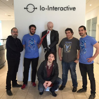 Abylight team visiting IO Interactive studios, with hitman behind them