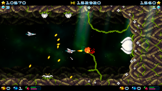 Super Hydorah co-op mode fighting against a plant monster, shooting at its roots and flowers